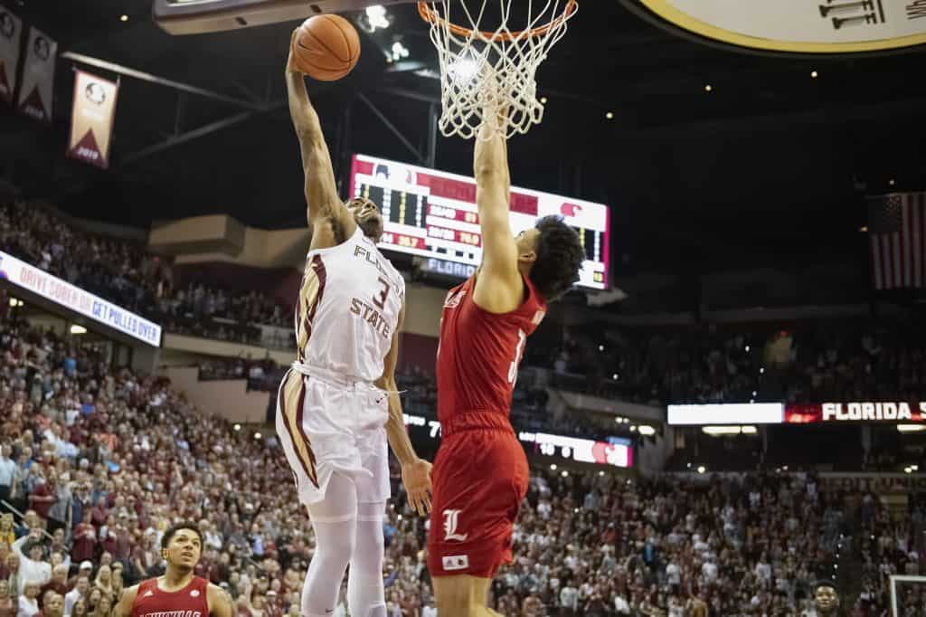 Florida State's senior point guard, Trent Forrest had a tremendous game that was capped off by a stunning, high-flying dunk over Jordan Nwora to help get his team the win over Louisville.  (Photo: Mike Olivella/The Osceola.)